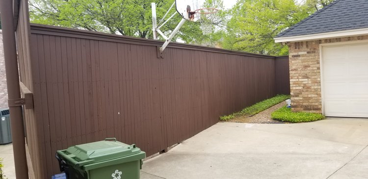 New wood fence surrounding house